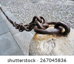 Old Anchored Iron Chain On The...