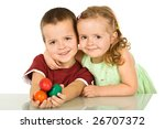 Happy easter kids smiling with a handful of eggs - isolated - stock photo