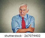 portrait of unhappy grumpy... | Shutterstock . vector #267074402