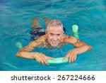 Old Man Swimming In Water Of...