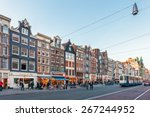 Stock photo amsterdam the netherlands march sunset view of the famous damrak with shops hotels 267244952
