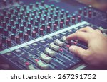 Hand adjusting audio mixer - stock photo