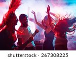 Stock photo group of energetic friends dancing in night club 267308225