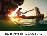 young lady paddling the kayak...   Shutterstock . vector #267326792