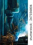 robots welding in a car factory | Shutterstock . vector #267336806