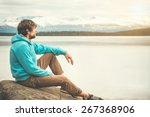 young man relaxing alone... | Shutterstock . vector #267368906