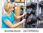 happy woman chooses loads for...   Shutterstock . vector #267390032