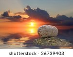 stones in the water on sunset... | Shutterstock . vector #26739403