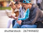 group of teenagers sitting... | Shutterstock . vector #267444602