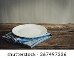 white plate on a napkin. on... | Shutterstock . vector #267497336