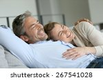 mature couple relaxing in sofa  ... | Shutterstock . vector #267541028