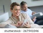 mature woman using smartphone ...   Shutterstock . vector #267541046