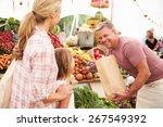 Family Buying Fresh Vegetables...
