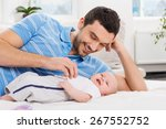 happy young father playing with ... | Shutterstock . vector #267552752