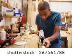 apprentice planing wood in...
