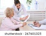 happy doctors and patient in... | Shutterstock . vector #267601325
