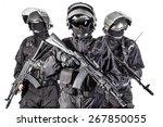 Russian special forces operators in black uniform and bulletproof helmets