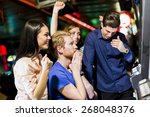 young group of people gambling... | Shutterstock . vector #268048376