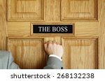 Businessman Knocking On A Door...