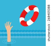 lifebuoy for drowning man in... | Shutterstock .eps vector #268405388