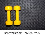yellow dumbbells on a black... | Shutterstock . vector #268407902