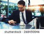 handsome young businessman use... | Shutterstock . vector #268450046