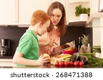 mother and child in the kitchen | Shutterstock . vector #268471388