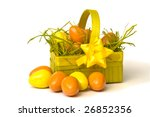 Yellow and orange Easter eggs in green basket - stock photo