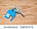 silver key with blue house... | Shutterstock . vector #268524176