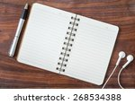 open diary  a pen and headphone ... | Shutterstock . vector #268534388