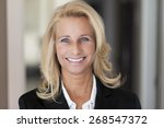 mature woman smiling at the... | Shutterstock . vector #268547372