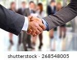 Closeup Of A Business Handshak...