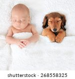 Sleeping Newborn Baby Alongsid...
