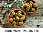 fresh olives and olive oil  on... | Shutterstock . vector #268582448
