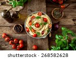 italian cuisine. pasta with... | Shutterstock . vector #268582628