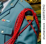 Small photo of Detail of the aiguillette in the uniform of the spanish Civil Guard. Guardia Civil. Spain