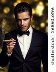 handsome man with cuban cigar...   Shutterstock . vector #268605896