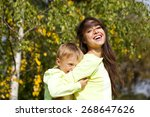 happy little boy and mother... | Shutterstock . vector #268647626