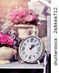 retro alarm clock with flowers. ... | Shutterstock . vector #268666712