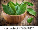 Fresh Bay Leaves In A Wooden...