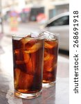 glass of cola with ice cubes | Shutterstock . vector #268691918