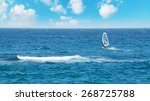 windsurfer alone on a cloudy day | Shutterstock . vector #268725788