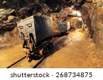 Mining cart in silver, gold, copper mine - stock photo