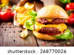 hamburger with fries on wooden... | Shutterstock . vector #268770026