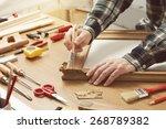 Man Varnishing A Wooden Frame...