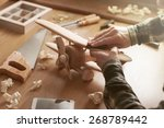 craftsman smoothing a wooden... | Shutterstock . vector #268789442