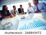 paper with charts and glass of... | Shutterstock . vector #268843472