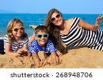 happy family   mother and two... | Shutterstock . vector #268948706