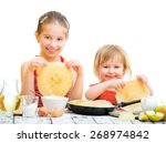 funny sisters cooking pancakes...   Shutterstock . vector #268974842