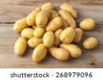 Raw Baby Potatoes On Rustic...